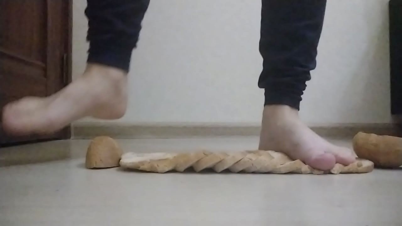 Girl crushing bread with barefeet