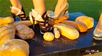Two girls crushing bread in high heels.